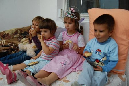 Four Kids Veggin out, looks like they are wrapping up a birthday party!